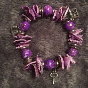 Stylish shell and beads charm bracelet